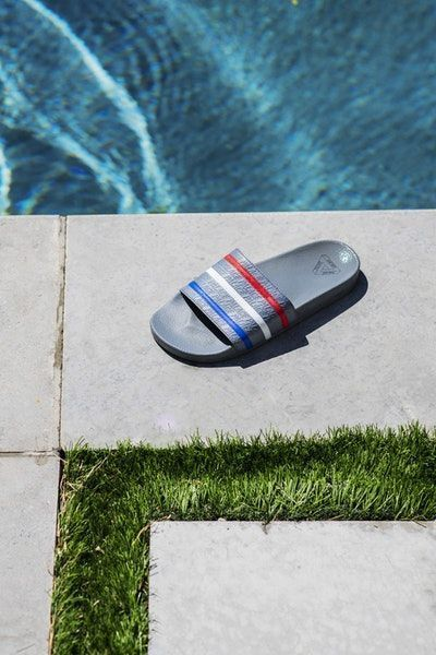 low priced 3e5e1 6ad6b The lookbook transmits summer in its purest form. A summer lookbook in  which adilette sandals and stylish winks to vintage football silhouettes  take centre ...